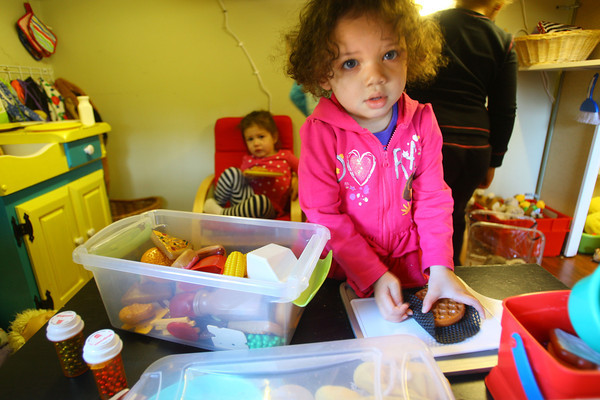 2-5-14   ---  Caterpillar Clubhouse Daycare on North Armstrong owned and operated by Stephanie McKinstry.Addie Wright plays in the clubhouse kitchen. -- <br />   KT photo | Tim Bath