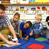 2-24-14<br /> Darrough Chapel Head Start<br /> Mr. Eastom shows from left: Ja'Nya Mahan, Kyrii Minor-Thornton, Kelly Miller, and Nathan Cox an activity they will be doing in their classroom at Darrough Chapel.<br /> KT photo | Kelly Lafferty