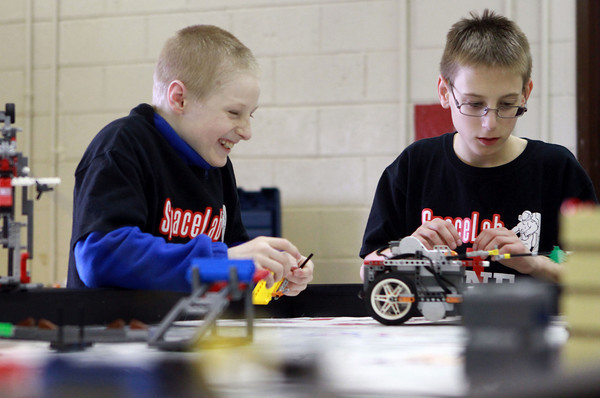 2-12-14<br /> Central Middle School robotics<br /> Central Middle School students Nathanael Elkin, left, and Ethan Smith watch as their robot makes its way to a mission.<br /> KT photo | Kelly Lafferty
