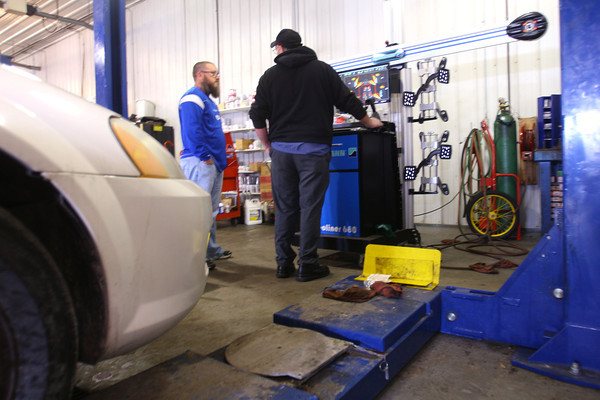 1-27-14   --- Joey Kimbrough working with Chuck DeVore at Burnett's Service Center  in Indian Heights. Kimbrough is the owner and has made large investments in the business recently with a wheel alignment machine and other equipment.  -- <br />   KT photo | Tim Bath