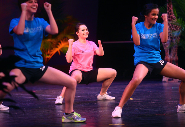 2-15-14<br /> Distinguished Young Women Saturday<br /> Christine Medin (center) of Elkhart shows off her fitness in Distinguished Young Women's program on Saturday evening.<br /> KT photo | Kelly Lafferty