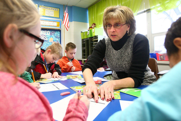 2-20-14<br /> Robyn Dill at NWES<br /> Northwestern Elementary teacher Robyn Dill helps second grader Isabelle VanSickel with a worksheet after a reading group in class.<br /> KT photo | Kelly Lafferty