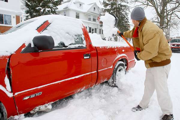 2-5-14   ---  Julian Roark shoveling snow from around his truck at 1107 West Walnut after the plows piled it next to the truck. -- <br />   KT photo | Tim Bath