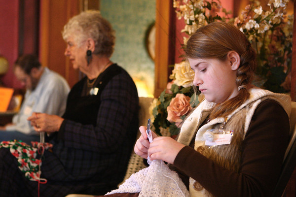 2-22-14<br /> Winter Woolen Workshop<br /> Gabriella Weaver, who came with her great grandparents to the Winter Woolen Workshop, crochets inside the Seiberling Mansion on Saturday.<br /> KT photo | Kelly Lafferty