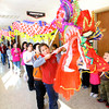 2-3-14   ---  Leading the dragon in the parade are Sycamore Students Wilmer Corrales, Chris Qui, Liseth Corrales and Zaret Zimbron. -- <br />   KT photo | Tim Bath