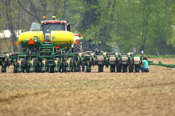 5-7-14   --- Stephanie Davison works on the planter while planting one of the family fields on the Jordan farm that she farms with her parents at 400 West and 100 South. -- <br />   Tim Bath | Kokomo Tribune