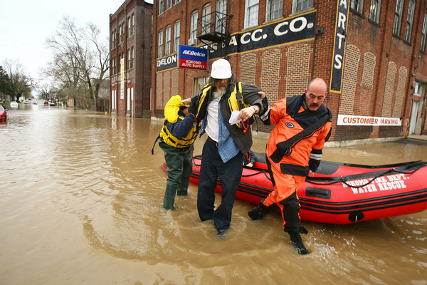4-19-13<br /> Flooding throughout Kokomo and Howard County due to over 4 inches of rain. Kokomo firefighters help Steven Loshel out of the boat on South Union Street that they used to rescue him from his home on East Carter Street.<br /> KT photo | Tim Bath