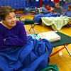 4-19-13<br /> Flooding throughout Kokomo and Howard County due to over 4 inches of rain. Kathy Elrod sits on a cot at Memorial Gym with a blanket trying to warm up after being displaced from her Washington Street home. The American Red Cross set up an emergency shelter for those displaced.<br /> KT photo | Tim Bath