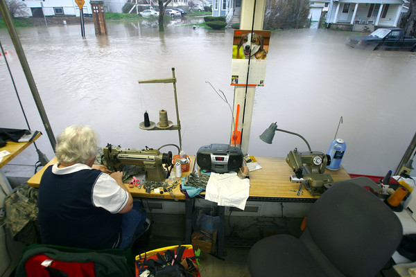 4-19-13<br /> Flooding throughout Kokomo and Howard County due to over 4 inches of rain.<br /> Jane Le Vee continues to work Friday morning at Stites Cleaners as the water rises outside the window. The water continued to rise all day Friday.<br /> KT photo | Tim Bath