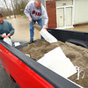 4-19-13<br /> Flooding throughout Kokomo and Howard County due to over 4 inches of rain. Owner of Scott Lithography at 310 South Union street, Scott Hemmberger and Terry Finley bag sand to put in front of the doors of the business to stop the water.<br /> KT photo | Tim Bath