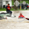 4-19-13<br /> Taylor Township Volunteer Firefighters rescue Jimmy White from his truck that was swept away in the water rushing over the Wildcat Creek bridge and roadway on 300 East just south of 100 North on Friday morning.<br /> KT photo | Tim Bath