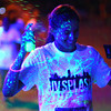 8-1-14<br /> Glo in the 'Mo, UV Splash by Color Dash and the Kokomo Family YMCA <br /> A runner gets sprayed with UV water as she crosses the finish line of Glo in the 'Mo, a UV Splash 5K benefiting the YMCA.<br /> Kelly Lafferty | Kokomo Tribune