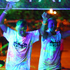 8-1-14<br /> Glo in the 'Mo, UV Splash by Color Dash and the Kokomo Family YMCA <br /> Logan Williams and Kaila Claiborne hold hands and get sprayed with the UV water as they cross the finish line of Glo in the 'Mo, the UV Splash 5K benefiting Kokomo's YMCA.<br /> Kelly Lafferty | Kokomo Tribune