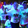 8-1-14<br /> Glo in the 'Mo, UV Splash by Color Dash and the Kokomo Family YMCA <br /> Runners and walkers get sprayed with UV water, making them glow under blacklights, at the station on Sycamore and Buckeye during Glo in the 'Mo, a UV Splash fundraiser for the YMCA.<br /> Kelly Lafferty | Kokomo Tribune
