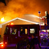 12-8-13  --  Around midnight Greentown firefighters were called to an apartment fire at Mill and Grant Streets in Greentown. The building was already fully engulfed in flames. Witnesses say that a few heroes were knocking on doors and helping residents out. Six apartments were completely destroyed while the remainder sustained major damage.<br />   KT photo | Tim Bath