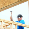 7-12-14<br /> Habitat for Humanity Apostles Build<br /> Jeff Marrah of St. Joan of Arc Catholic Church hammers inside of the 1921 S. Bell Street house during Saturday's Habitat for Humanity Apostle Build.<br /> Kelly Lafferty | Kokomo Tribune