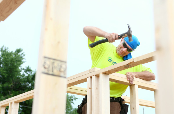 7-12-14<br /> Habitat for Humanity Apostles Build<br /> Randy Teachout of Bible Baptist Church  works inside the 1921 S. Bell Street home on Saturday during Habitat for Humanity's Apostle Build.<br /> Kelly Lafferty | Kokomo Tribune