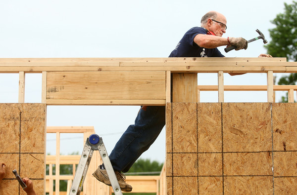 7-12-14<br /> Habitat for Humanity Apostles Build<br /> Joe Warner of Macedonia Christian Church hammers a nail on the frame of 1921 S. Bell Street during Habitat for Humanity's Apostles Build.<br /> Kelly Lafferty | Kokomo Tribune
