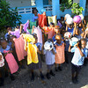 2-20-14   --- Solar Electric system installed in Bas Limbe, Haiti at Our Lady of Mt Carmel Catholic Church. Kids sponsored for books, uniforms and tuition through St. Joan of Arc parishioners are given dresses and soccer balls. -- <br />   KT photo | Tim Bath