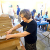 2-19-14   --- The Haitian Environmental Support Program(H.E.S.P.) founded by Doug Vaughn and the Lions Club traveled to Pilate, Haiti to fit about 1500 Haitians with glasses. Linda Winkleman looks for a pair of glasses that will fit a young lady.  -- <br />   KT photo | Tim Bath