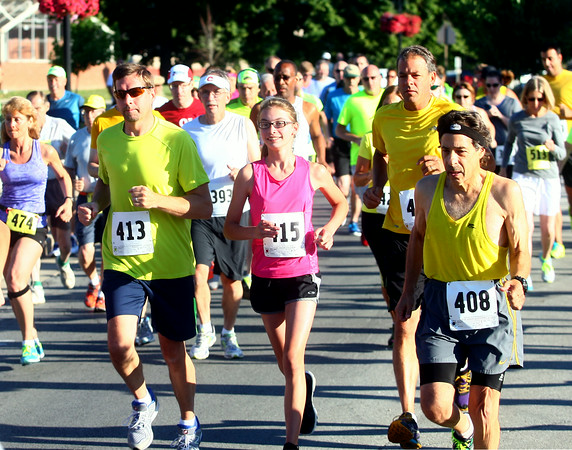 7-5-14<br /> Haynes Apperson Sports<br /> Runners begin the Haynes Apperson 4-mile run at Memorial Gym on Saturday morning.<br /> Kelly Lafferty | Kokomo Tribune