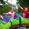 7-4-14<br /> Haynes Apperson Friday<br /> Siblings Tegan and David Sands throw their hands up during a ride at the Haynes Apperson Festival on Friday.<br /> Kelly Lafferty | Kokomo Tribune