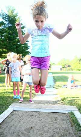 7-5-14<br /> Haynes Apperson Sports<br /> 7-year-old Rachel Garro gets some air as she jumps into the sand during the long jump at the Haynes Apperson Kids Track Meet.<br /> Kelly Lafferty | Kokomo Tribune