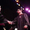 5-13-14<br /> IUK graduation<br /> Arwa Ahmad Albawardi, originally of Saudi Arabia, shakes hands with IUK Chancellor Susan Sciame-Giesecke as he walks across the stage for his diploma during the graduation ceremony on Tuesday.<br /> Kelly Lafferty   Kokomo Tribune