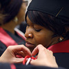 5-13-14<br /> IUK graduation<br /> Nkeiruka Ugwu gets help with tying her highest distinction cords before the IUK graduation ceremony on Tuesday.<br /> Kelly Lafferty | Kokomo Tribune