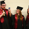 5-13-14<br /> IUK graduation<br /> Justin Clark facetimes with his family before the IUK graduation ceremony begins as fellow graduates Alyson Goldner and Kristen Willhoite watch.<br /> Kelly Lafferty | Kokomo Tribune