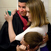 5-13-14<br /> IUK graduation<br /> IUK graduate Heather McKee hugs her two kids, 12-year-old daughter Phoenix McKee, and 7-year-old son Jesse Swisher before the start of the graduation ceremony on Tuesday.<br /> Kelly Lafferty | Kokomo Tribune