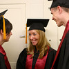 5-13-14<br /> IUK graduation<br /> From left: Heather Shively, Tara Slaga, and Nick Snyder talk as they wait in line for the IUK graduation ceremony to start.<br /> Kelly Lafferty   Kokomo Tribune