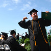 5-10-14<br /> Ivy Tech Graduation<br /> Casey Wilson celebrates after walking of the stage with his diploma at the Ivy Tech graduation ceremony on Saturday.<br /> Kelly Lafferty | Kokomo Tribune