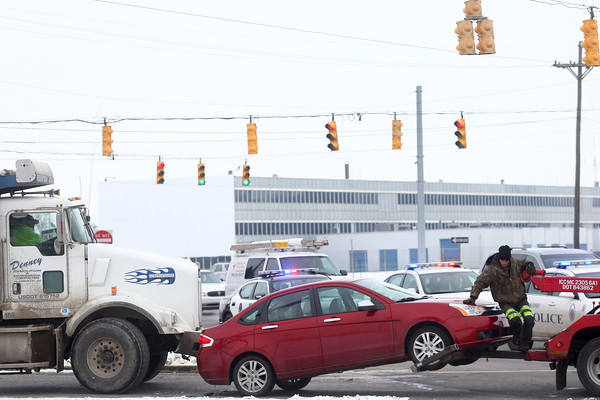 1-3-12<br /> A car gets towed off the scene of an accident on Lincoln and 31 on Thursday afternoon.<br /> KT photo | Kelly Lafferty
