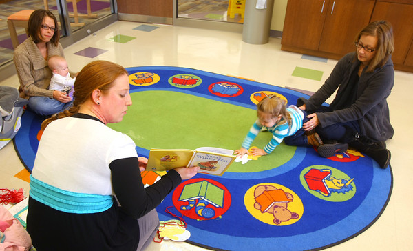 1-9-13<br /> Kokomo Howard County Public Library reading program designed for babies under 3. Lots of hands on visuals with the reading and songs. Children's Librarian Amber Sefton reads a book to the toddlers.<br /> KT photo | Tim Bath