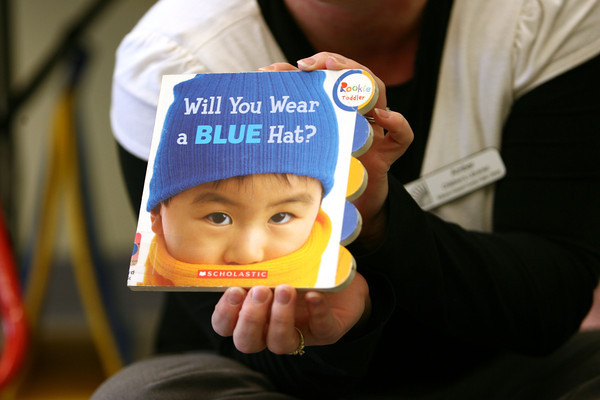 """1-9-13<br /> Kokomo Howard County Public Library reading program designed for babies under 3. Lots of hands on visuals with the reading and songs. Amber Sefton gets ready to read the book """"Will You Wear a BLUE Hat?""""<br /> KT photo 