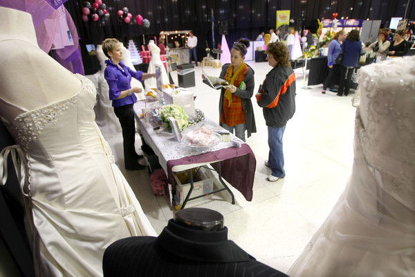 1-13-13<br /> Bridal Show at the Kokomo Event and Conference Center. Booths displaying everyones wedding products like this one with dresses and tuxes from Mirror Mirror Consignment Shop<br /> KT photo | Tim Bath