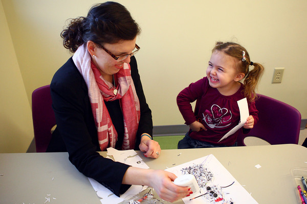 1-11-13<br /> After school crafts<br /> 3-year-old Emma Zapata enjoys making a snowman craft with her mom Anika Zapata at the library on Friday afternoon.<br /> KT photo   Kelly Lafferty