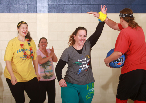 1-18-14<br />  Last One Standing Dodge Ball Challenge to benefit Bona Vista Programs<br /> Mary Buchholz high fives Brandy Christiansen as their teammates Melissa Boonstra and Lindsey Davison come to congratulate them after their team, the Minnows, won a game during Last One Standing Dodge Ball Challenge on Saturday.<br /> KT photo | Kelly Lafferty