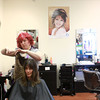 1-19-14<br /> Camilla Chesshir gets hair cut to donate it to make a wig for a co-worker who has cancer<br /> Camilla Chesshir gets her hair cut by Charlien Haworth of Beauty Buzz. Chesshir is donating her hair to make a wig for a co-worker who has cancer.<br /> KT photo | Kelly Lafferty