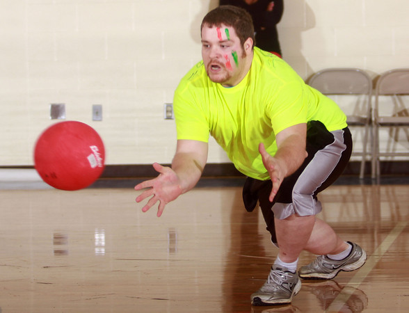 1-18-14<br />  Last One Standing Dodge Ball Challenge to benefit Bona Vista Programs<br /> Ryan Frigge of The Highlighters attempts to catch a ball during Last One Standing Dodge Ball Challenge to benefit Bona Vista Programs at Maple Crest Middle School on Saturday morning.<br /> KT photo | Kelly Lafferty