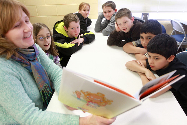 "1-16-14<br /> Kokomomentum at Carver Community Center<br /> IUK student Karen Bowlin (left) reads a book called ""Sticky, Sticky, Stuck"" to a group of young students at Carver Community Center during Kokomomentum.<br /> KT photo 