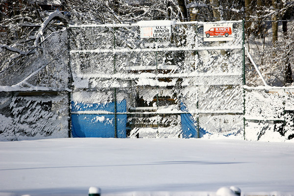 1-6-14   --- Heavy snow blanketed Kokomo and surrounding areas with cold temp below zero. UCT park snow that stuck to the backstop. -- <br />   KT photo | Tim Bath