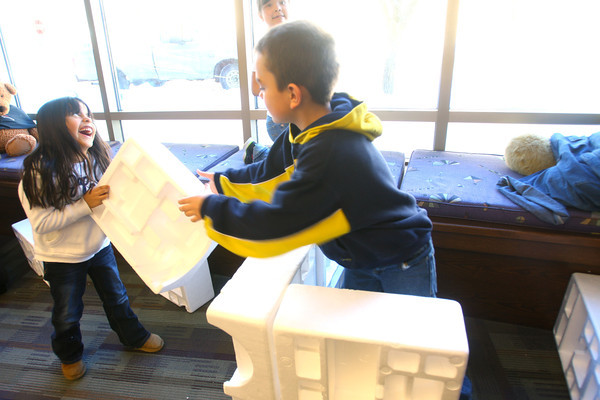 1-28-14   --- Getting in out of the cold at the Kokomo Howard County Public Library. Shaela Brazzel, 6, Jasphan Thomas, 9, and Sophia Kenworthy, 5(back) play with styrofoam blocks at in the childrens activity area. -- <br />   KT photo | Tim Bath