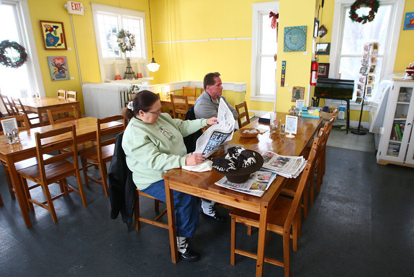 1-2-14<br /> Cafe Du Cirque<br /> Chris and James Mellady spend part of their morning at Cafe Du Cirque in Peru.<br /> KT photo | Kelly Lafferty