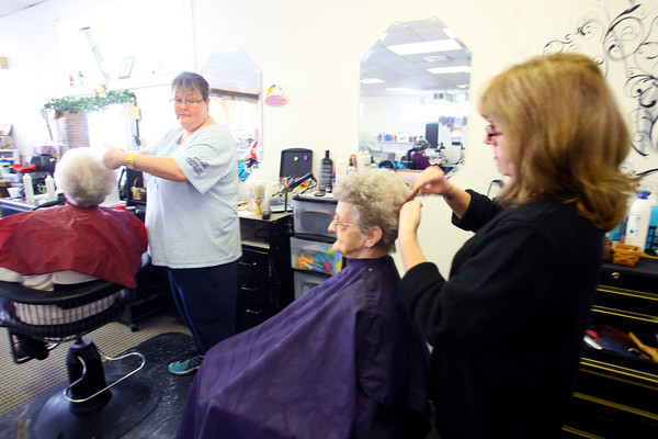 1-17-14   --- Hair's All of Us salon is a group of ladies who lost their businesses on Arnold Court in the November tornado. Venica Hokenson talks about being in the bathroom between the two businesses when the storm came through. She lived upstairs. Sandy Griffin is working on her hair. Brandy Clark is cutting hair to the left. -- <br />   KT photo | Tim Bath