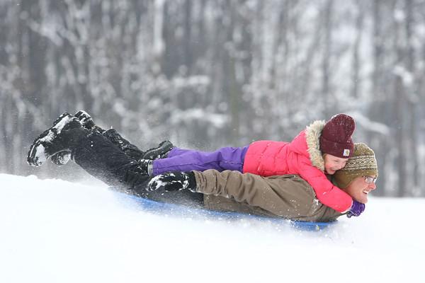 1-9-14   --- Kira Ropes, 5, and her dad Blake Ropes sled riding at Jackson Morrow Park.  -- <br />   KT photo   Tim Bath