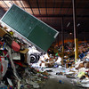 1-2-14<br /> Recycling<br /> A recycling bin is dumped of its recycled materials at Kokomo Recycle Center on Thursday.<br /> KT photo | Kelly Lafferty