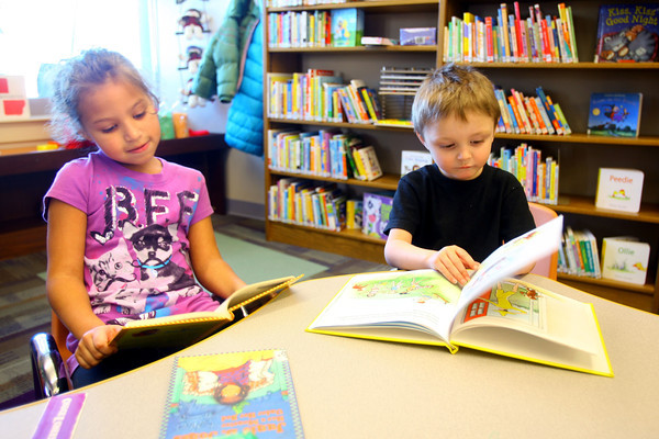 1-28-14   --- Getting in out of the cold at the Kokomo Howard County Public Library. Isabell Chavez, 6, and Austin Yard, 3, reading books at the library. -- <br />   KT photo | Tim Bath