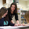 1-22-14<br /> Superbowl Project at Taylor HS<br /> Jessica Breedlove, Taylor High School teacher, helps Haylee Carlile with her Superbowl Project.<br /> KT photo | Kelly Lafferty
